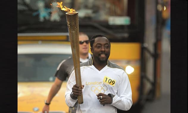 Black Eyed Peas' will.i.am Carries Olympic Torch in England