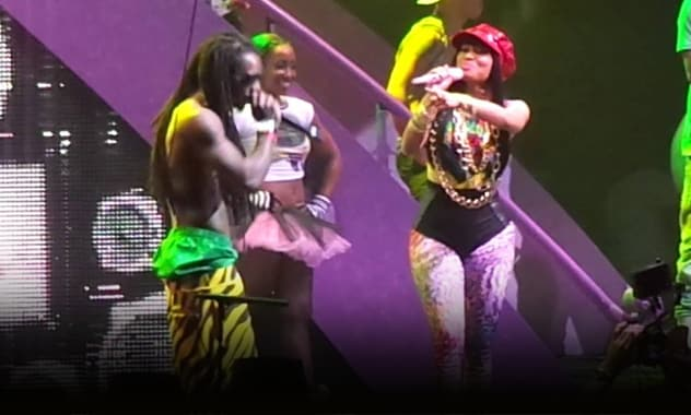 Nicki Minaj In Miami: Fan Rushes Stage, Gets Beaten By Security As Singer Seems Unfazed  1