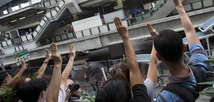 Thailand's Coup Protestors Use 'Hunger Games' Symbol In Opposition