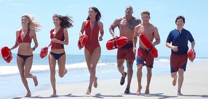 Zac Efron Makes Good Sport Of Himself After Taking Unexpected Dive Into The Sand During Baywatch Scene